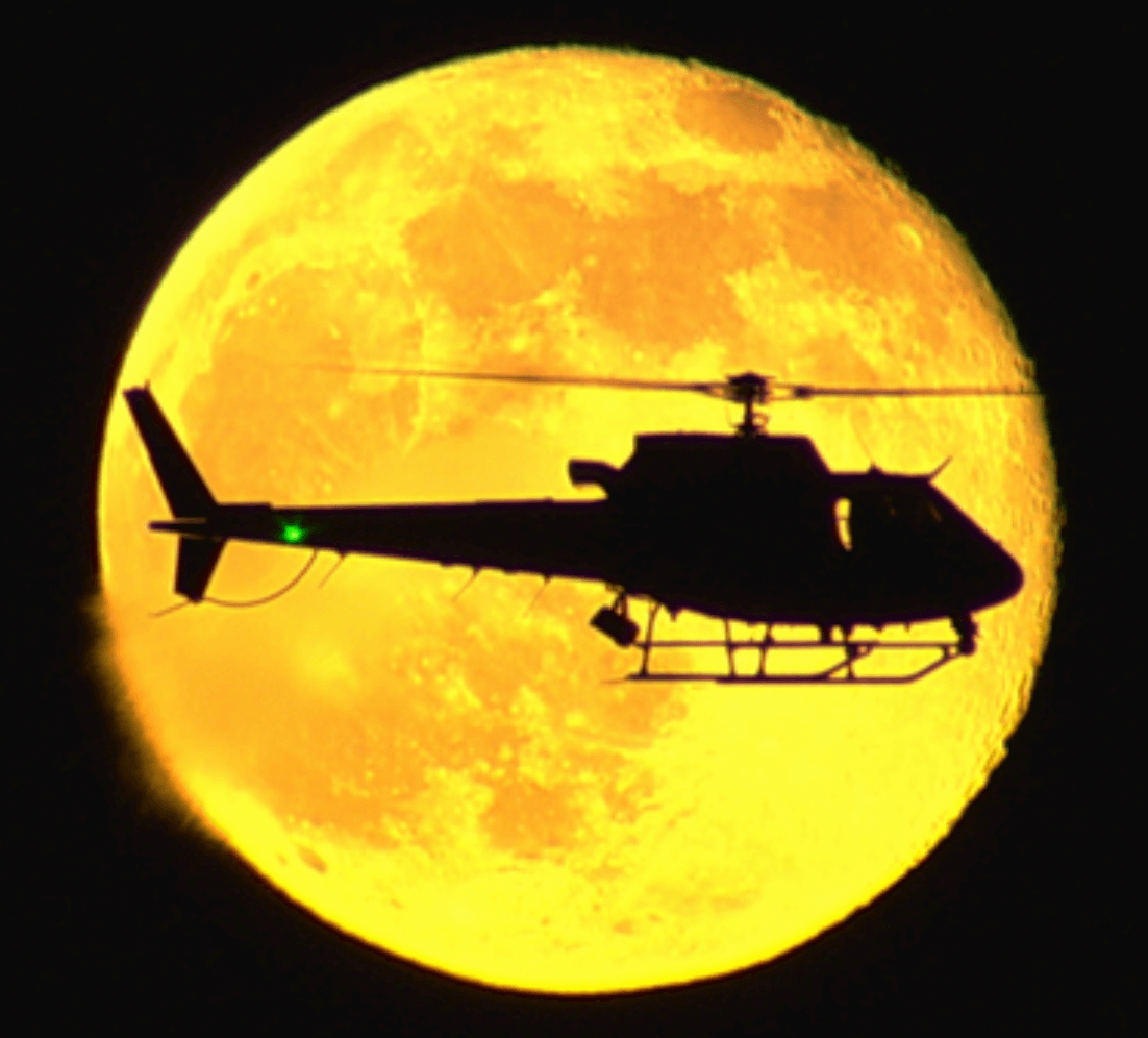 Chopper in front of the moon